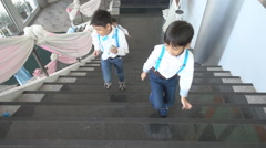 Children running up on step playing together Stock Footage