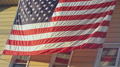 Large American Flag on side of a House Stock Footage
