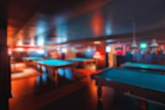 Abstract blur. brand new and modern billiard interior in night time Stock Photos
