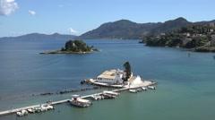 4K Aerial view Pontikonisi Island emblem and Vlacherna Monastery landmark Corfu Stock Footage