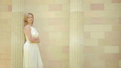 Beautiful girl walking on the Arabic palace. tourism concept. white lace dress Stock Footage