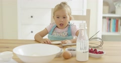 Cute baby baking in a kitchen Stock Footage