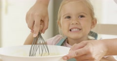 Fascinated little girl learning to bake Stock Footage