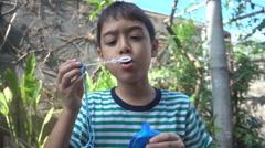Little boy blowing bubble soap close up slow motion HD Stock Footage
