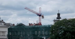 Building Under Construction With Crane in Old City Time Lapse Stock Footage