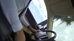 Hidden camera filming driver behind steering wheel, espionage, surveillance Stock Footage