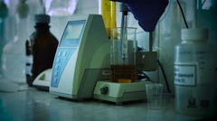 Analysis of oil or dark lager beer. Research lab assorted glassware equipment Stock Footage