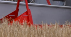 Vintage Combine Harvester at work in wheat field, Slow Motion Stock Footage