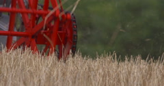 Red Combine Harvester Reel in summer wheat field 2K Slow-Mo Stock Footage