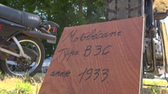 Old motorcycle in a exhibition - Motobecane type B3C (1933) with placard Stock Footage