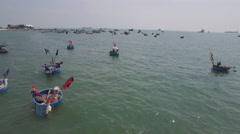 Aerial shot over traditional vietnamese fishing boats Stock Footage