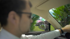 Attentive businessman controlling luxury car, fast driving through the city Stock Footage