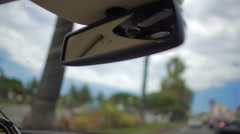 Rear view mirror close-up, person travelling by car, driving in the city Stock Footage