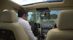 Test drive, businessman pleased with car and showing thumbs up hand sign Stock Footage