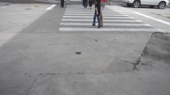 Woman walking cross the road over pedestrian way for safety motion HD Stock Footage