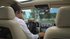 Male buyer testing new expensive automobile on the city roads, test drive Stock Footage