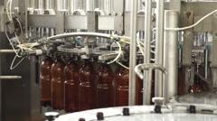 The conveyor belt production of beer in PET plastic bottles Stock Footage