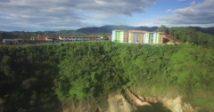 Aerial reveal from below of the Colombian town of Guatape Stock Footage