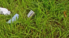 Pollution.Garbage abandoned in a meadow of grass Stock Footage