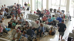 Passengers wait to board airplane in a waiting room at Danube Delta airport Stock Footage