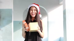Asia thai teen beautiful girl happy new year and give gift, relax and smile. Stock Footage