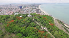 Aerial of Jesus Christ statue along Vung Tau beach coast Stock Footage
