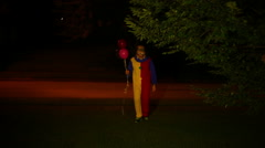 disturbing clown at night walking - stock footage