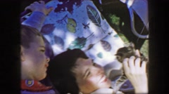 1957: Mother son playing cute kitten outdoor tree shade summer relaxing.  GLEN, Stock Footage