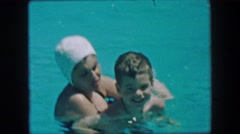1957: Mother son training swimming closeup in calming blue waters. GLEN, NEW Stock Footage