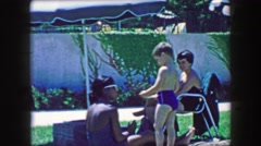 1957: Multiracial family friends enjoying public pool summertime relaxation. Stock Footage