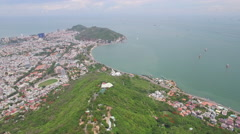 Aerial over Ho May hill surrounded by Vung Tau bay Stock Footage