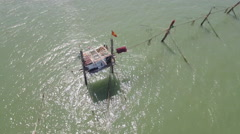 Aerial over vietnamese fishing house over sea Stock Footage