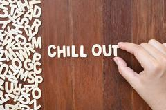 Word chill out  made with block wooden letters Stock Photos