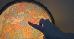 Woman Traces Genealogical Origins on a Vintage Globe Lamp Stock Footage