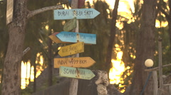 CLOSE UP: Wooden signs showing distances to major countries and cities Stock Footage