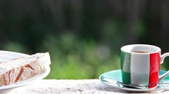 Italian breakfast with coffee, bread and jam. Cup with italian flag. Full HD Stock Footage