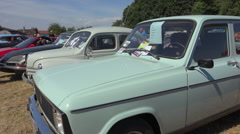 French vintage car - old Renault 6 TL (1978) in a collector's car meeting - pan Stock Footage