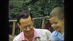 1957: Father son petting zoo closeup fun popcorn food to animals. GLEN, NEW Stock Footage