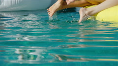 Legs in the pool. Vacation at summer. 20s. 1080p Slow Motion Close up Stock Footage
