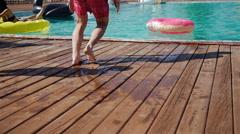 Man jumping in pool, huge splash. 20s. 1080p Slow Motion Stock Footage