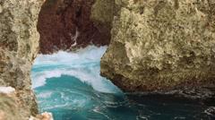 Waves filling narrow opening in reef - Nusa Dua Waterblow, Bali Stock Footage