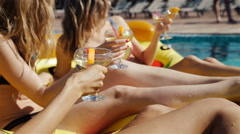 Happy girls with beverages on summer party near the pool. 20s. 1080p Slow Motion Stock Footage