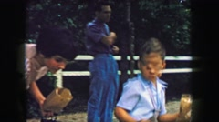 1957: Boy feeding animals petting zoo bag of popcorn food. GLEN, NEW HAMPSHIRE - stock footage
