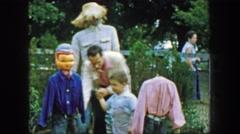 1957: Father son playing autumn festival headless scarecrow display. GLEN, NEW Stock Footage
