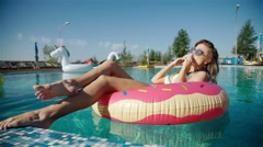 Friends or teenage girl in sunglasses eating ice cream at the pool. 20s. 1080p - stock footage
