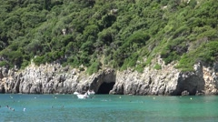 4K Tourist enjoy cave in Corfu Island people swimming in turquoise water summer  Stock Footage