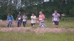 4K Competitive team in assault course race getting ready at the starting line Stock Footage