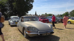 French vintage car - Citroën DS19 (1971), collector's car meeting - zoom out Stock Footage