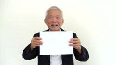 Old Asian senior businessman holding white sign Stock Footage