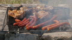 Barbecue scene, crispy grilled chicken and man puts sausages by Pakito. Stock Footage